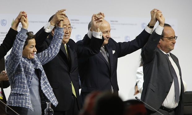 French foreign minister and president-designate of COP21 Laurent Fabius (centre), raises hands with UN secretary general Ban Ki Moon and French president François Hollande. Photograph: Francois Guillot/AFP/Getty Images